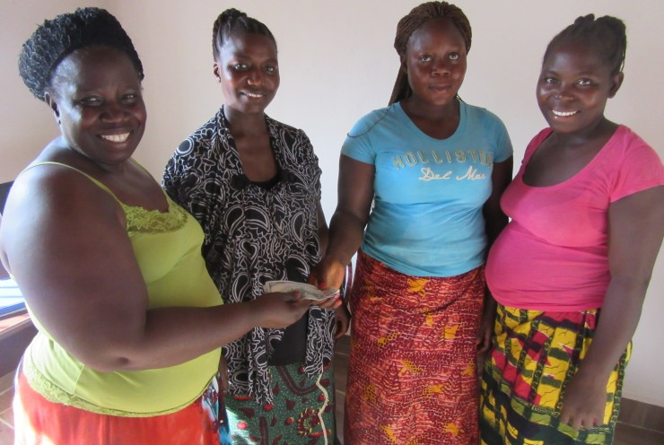 2nd from right- Koko receives her first loan to start business-IMG_2700