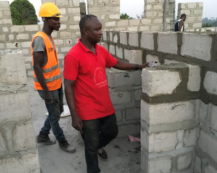 Chestin counting each brick with the brick layer